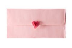 De roze envelop wordt verzegeld door een hart stock afbeelding
