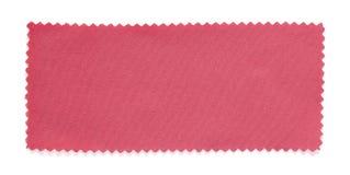 De roze geïsoleerde steekproeven van het stoffenmonster Stock Foto