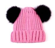 De roze gebreide geïsoleerde hoed van wolkinderen Royalty-vrije Stock Foto's