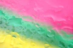 De roze groene en blauwe achtergrond van de waterdaling Stock Foto