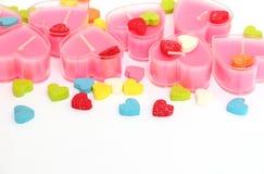 De roze kaarsen van de valentijnskaart Stock Foto's