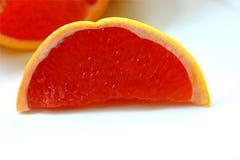 De roze plak van de Grapefruit royalty-vrije stock fotografie