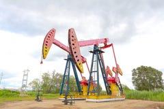 De roze van de het booreilandenergie van de Oliepomp industriële machine Stock Foto's