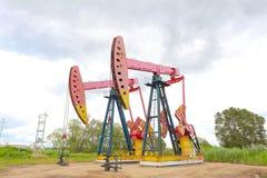 De roze van de het booreilandenergie van de Oliepomp industriële machine Stock Afbeeldingen