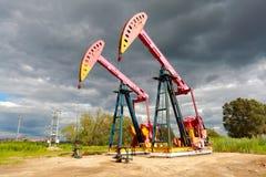 De roze van de het booreilandenergie van de Oliepomp industriële machine aan de kant van D Stock Foto