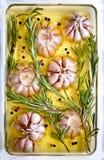 De rozemarijnolie van het knoflook stock foto's