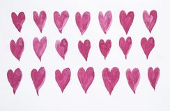 De rozerode kleine harten van de waterverfverf op de achtergrond van de Witboektextuur royalty-vrije stock afbeelding