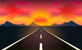 De rubriek van de weg aan de zonsondergang Stock Afbeeldingen