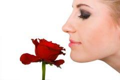 De ruikende bloem van de vrouw Stock Fotografie