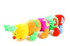 De rupsbandstuk speelgoed van jonge geitjes met 1234 (nadruk op 4) Stock Foto's