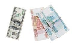De Russische roebel en de Amerikaanse dollar Stock Foto