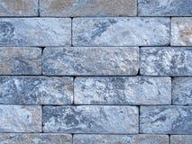 De ruwe bakstenen muur van aarde en terracotta kleurde grijze bakstenen Royalty-vrije Stock Foto's