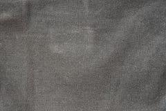 De ruwe donkere grijze achtergrond van de stoffen textieltextuur Royalty-vrije Stock Foto's