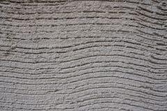 De ruwe golf texturized grijze muur Stock Afbeelding