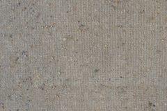 De ruwe oppervlakte van de natuursteen naadloze marmeren textuur met barsten, deuken, scherpe randen Grijze grungy geweven achter royalty-vrije stock foto