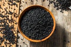 De ruwe Organische Zwarte Zaden van de Venkelbloem stock afbeelding