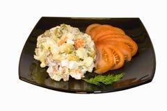 De salade van de aardappel op een plaat. Stock Foto