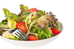 De salade van de tomaat en van de sla met een vork Royalty-vrije Stock Foto
