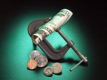 De samendrukking van het geld Stock Afbeeldingen