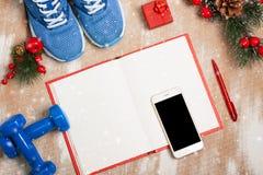De samenstelling van de Kerstmissport met schoenen, domoren, noteboo Royalty-vrije Stock Foto