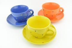 De samenstelling van drie kleurenkop theeën Stock Afbeelding