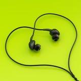 De samenstelling van in-oorhoofdtelefoons Stock Afbeeldingen