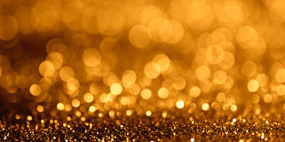 De samenvatting schittert bokeh licht op gouden achtergrond brede ventilatorpagina Royalty-vrije Stock Foto's