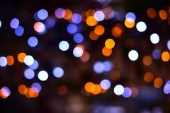 De samenvatting vertroebelde de kleurrijke achtergrond van bokehlichten Stock Fotografie