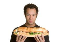 De Sandwich van de Holding van de mens stock foto's