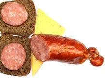 De sandwiches van de worst en van de kaas van roggebrood Stock Afbeelding