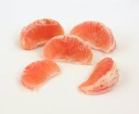 De sappige Plakken van de Grapefruit Stock Afbeeldingen