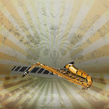 De saxofoon en de pianosleutels van de achtergrondmuziekjazz Royalty-vrije Stock Afbeeldingen