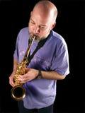 De saxofoonspeler Stock Fotografie