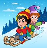 De scène van de winter met jonge geitjes op slee Royalty-vrije Stock Afbeelding