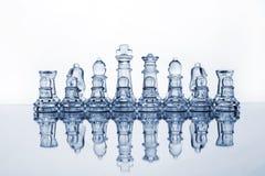 De schaakstukken van het glas stock fotografie