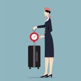 De Schaal van Weighting Luggage With van de luchtvaartlijnstewardess Royalty-vrije Stock Foto's