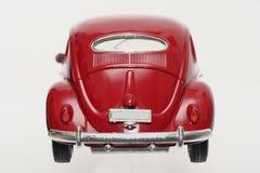 De schaalstuk speelgoed van het metaal model oude backview van VW Beatle 1955 Stock Foto