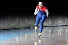De schaatser van de snelheid bij snelheid stock fotografie