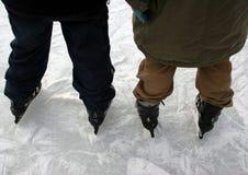 De schaatsers van het ijs stock afbeelding