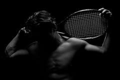 In de schaduw gestelde Tennisspeler Stock Foto's