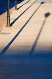 De schaduw van de straatlantaarn 's Stock Foto's