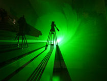 De schaduw van Grenn in laserlicht royalty-vrije stock afbeeldingen