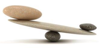 De schalen van de stabiliteit met grote en kleine stenen Stock Afbeelding