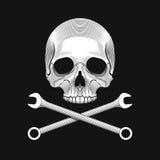 De schedel en de gekruiste moersleutels op de zwarte achtergrond Royalty-vrije Stock Foto