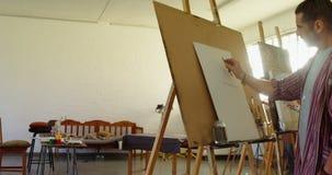 De schets van de kunstenaarstekening op canvas 4k stock footage