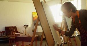 De schets van de kunstenaarstekening op canvas 4k stock videobeelden