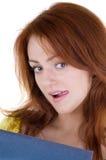 De schichtige glimlach van de jonge vrouw Stock Fotografie