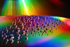 De schijf van DVD en CD met de kleurenachtergrond van waterdalingen stock foto