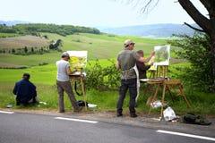 De schilders schilderen in openlucht Royalty-vrije Stock Afbeeldingen