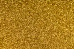 De schitterende gouden document achtergrond van de bladtextuur Fonkelend gouden geel patroon Royalty-vrije Stock Foto's